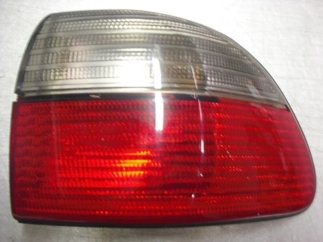 97 98 99 CATERA R TAIL LIGHT QUARTER PANEL MOUNTED 166 01716R 16733