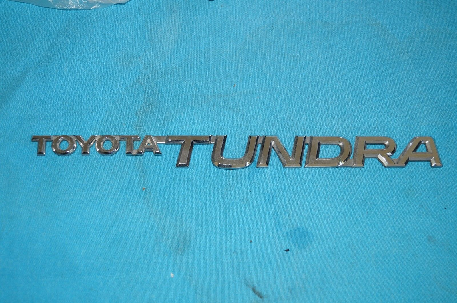 2000-2006 Toyota Tundra Door/Side Emblem Part #75471-0C010  75471-0C010
