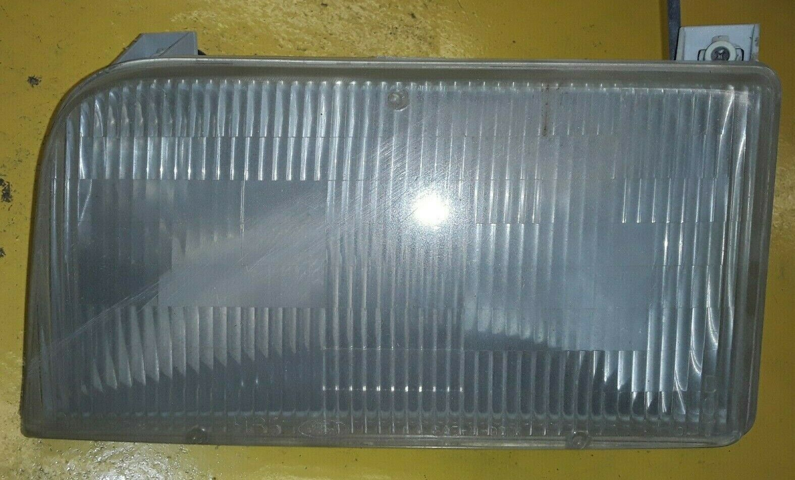 OEM 1992-1997 Ford F SERIES LEFT HEAD LIGHT ASSEMBLY 44ZH828A