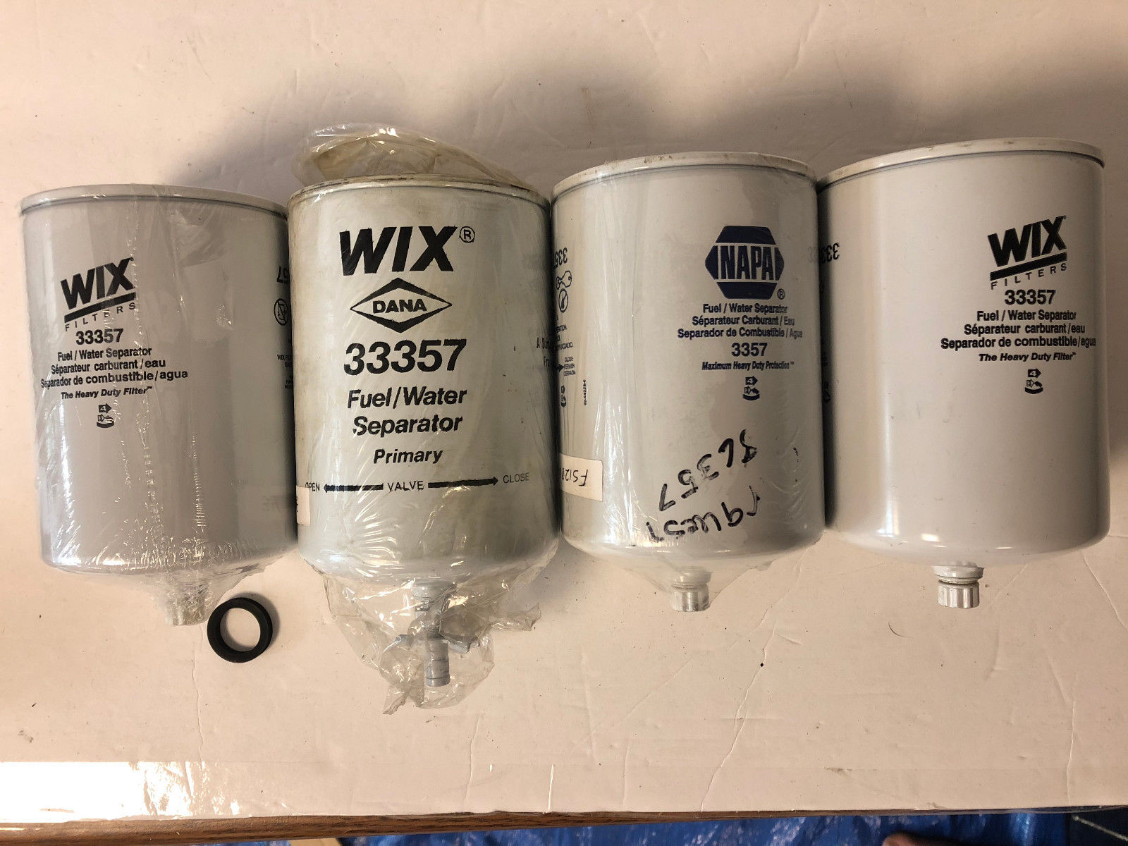 (LOT OF 4) 3, 33357 WIX 1, 3357 NAPA FUEL FILTER FS1280 Carrier Case Cummins 3357 33357 3925274