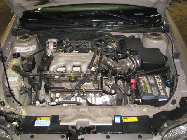 Where is the blower motor located on the 2000 chevrolet malibu autos post