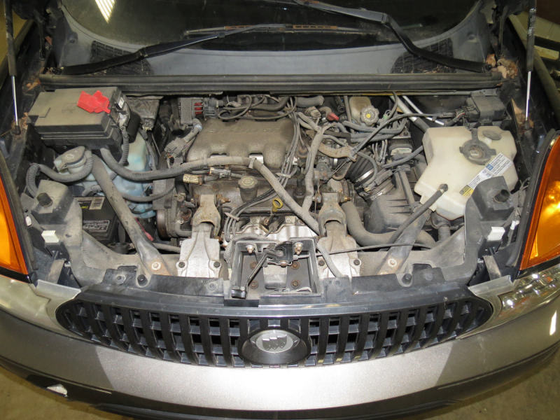 Engine And Wiring Under The Hood Of A 2005 Buick Rendezvous from img.justparts.com